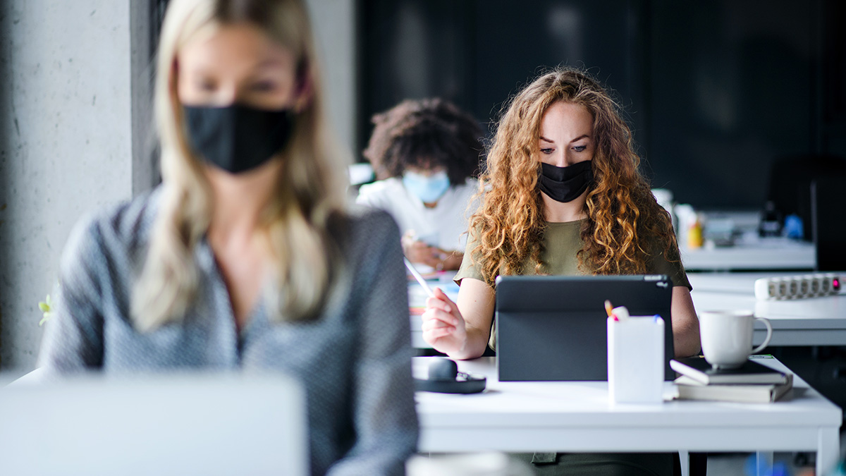Wearing masks at desk